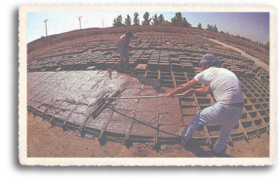 Workers making thousands of adobe bricks for use in modern-day house in Northen New Mexico. Adobe, with its properties of natural heating and cooling, is still one of the most desired forms of construction in the Taos area.